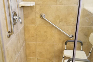 Two Grab Bars Installed On Tile With Shower Chair