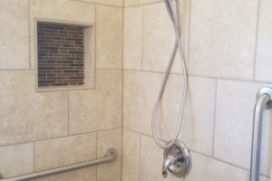 Two Stainless Steel Grab Bars Installed In Tiled Shower